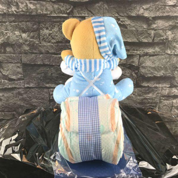 Der Teddybär ist stabil am Pampers Motorrad befestigt